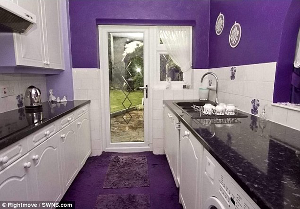 The arrangement of every piece of furniture within the home works harmoniously with its purple theme.