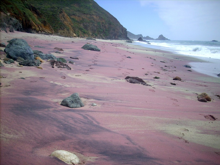 The foreign purple sand of the Pfeiffer Beach near California's Pfeiffer Big Sur State Park is mainly due to its manganese garnet deposits.
