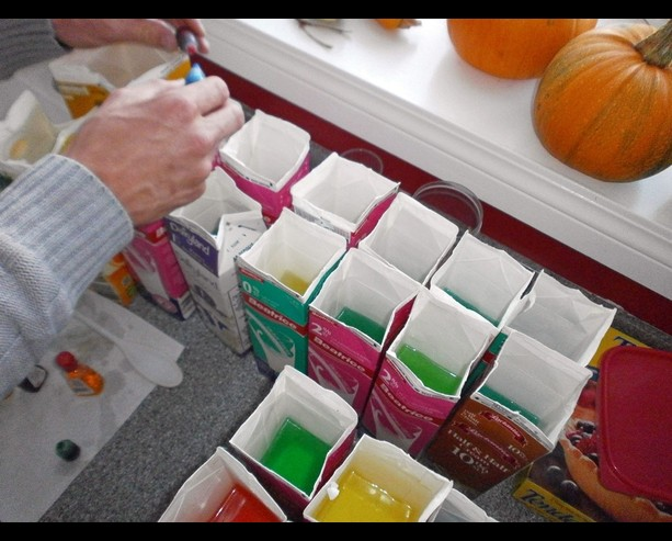 Filling the Milk Cartons with Colored Water