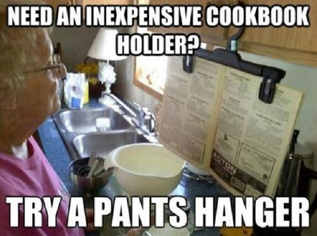 Need an inexpensive cookbook holder? Try a pants hanger.