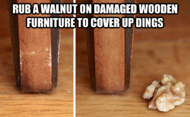 Rub a walnut on damaged wooden furniture to cover up dings.