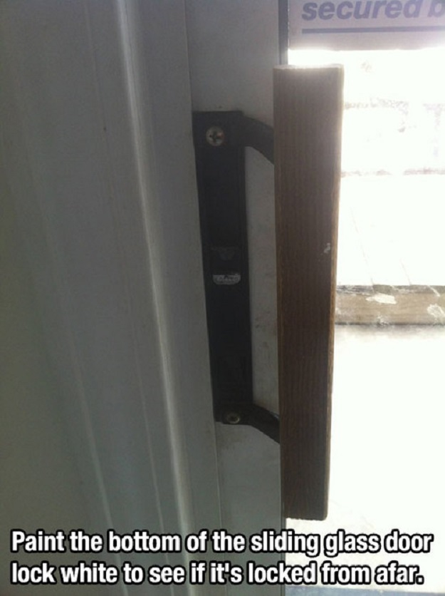 Paint the bottom of the sliding glass door lock to see it it's locked afar.