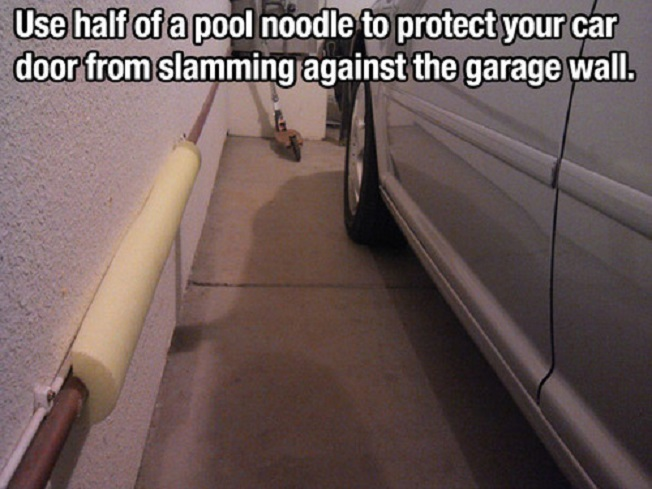 Use a half of a pool noolde to protect  your car door from slamming against the garage wall.