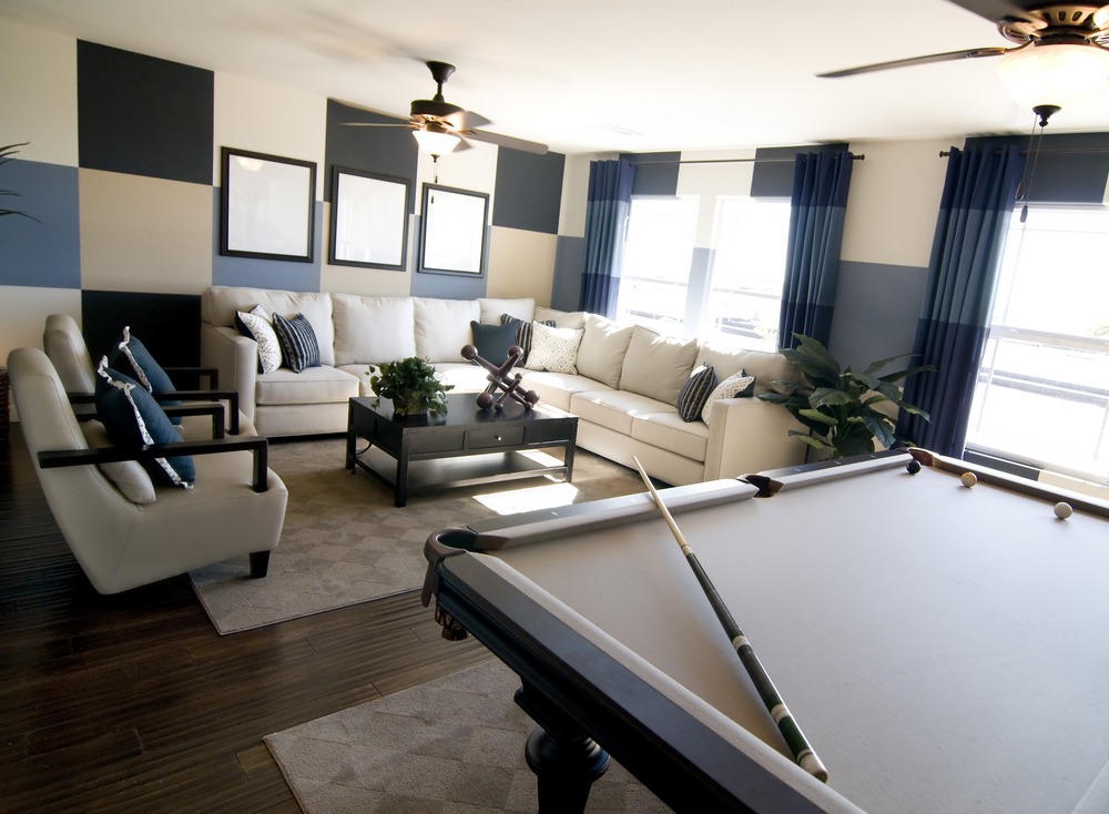 The above is a classic man cave with large sectional and billiard table.