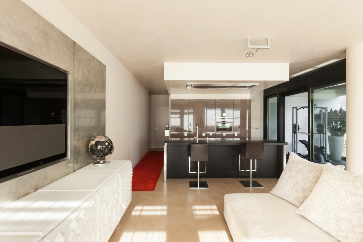I like the clean, contemporary design of this TV room and mini-bar.