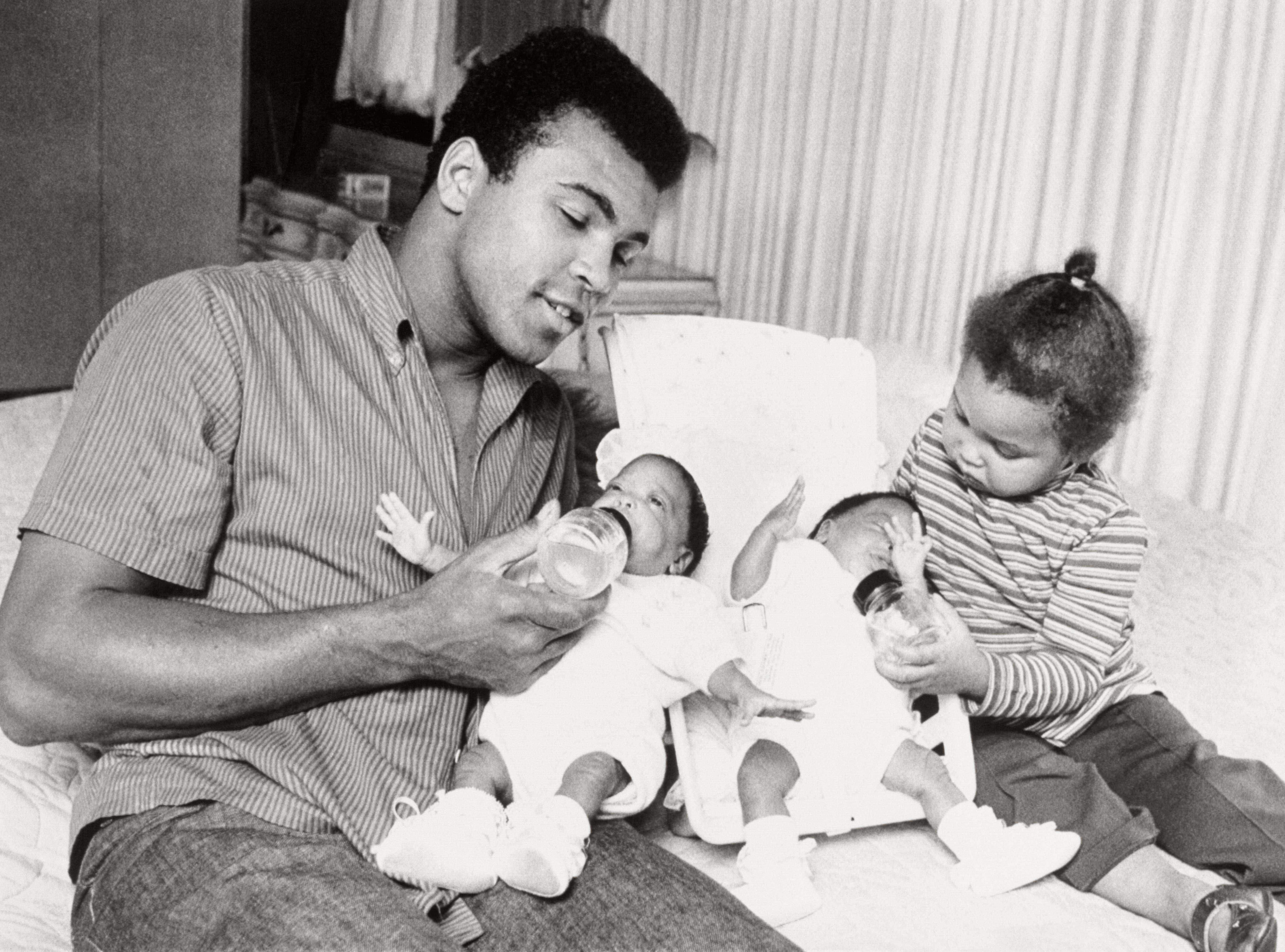 Cassius Clay with his newborn twins