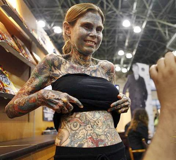 Julia Gnuse, the Guiness World Record's title holder of the Most Tattooed Woman in the World, did not have her entire face and body tattooed for no reason.