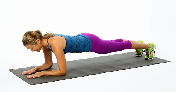 Exercise the Spiderman way by doing the plank position and inching your way forward and back.