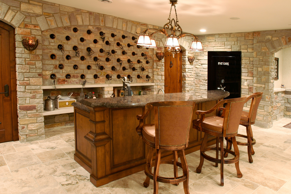 The wood and brick is a nice touch for a basement bar.  A great section of any man cave.