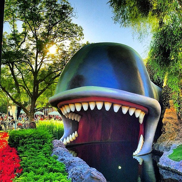 The water features in Disneyland are green or brown to hide the vehicle tracks and filtration systems.