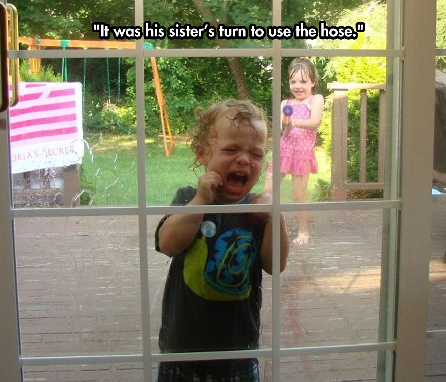 It was his sister's turn to use the hose.